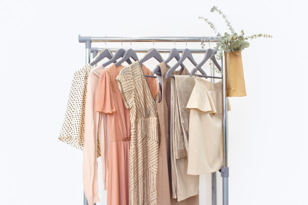 elegant-dress-jumper-trousers-other-fashion-outfit-pastel-beige-color-spring-cleaning-home-wardrobe_114937-307